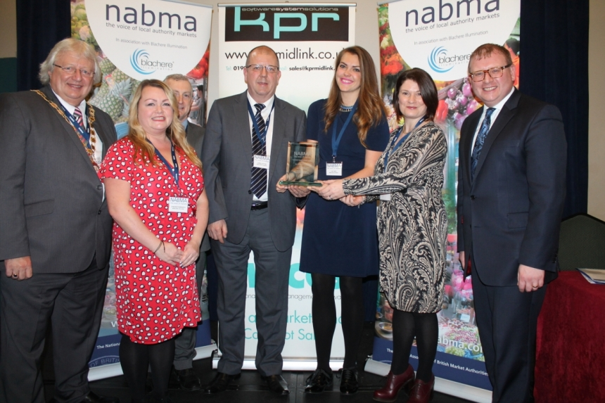 IMAGE l-R: Cllr Mick Barker, NABMA President, Lydia Butterworth, Head of Enterprise at Kirklees College, Jeremy Brabin, KPR Midlink the awards sponsor, Chris Cotton, Lucy Bye and Maria Cotton, Kirklees Council and finally Marcus Jones MP, Minister for High Streets and Markets
