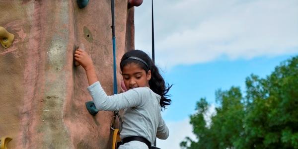 senior school transition day activity - girl on climbing wall