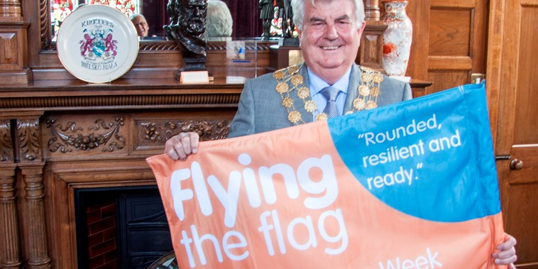 Cllr Jim Dodds with Kirklees Learning Week 2016 flag